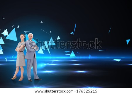 Serious businessman standing back to back with a woman against small pyramids on technical background - stock photo