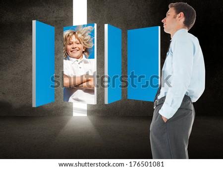 Serious businessman standing with hand in pocket against door in dark room - stock photo