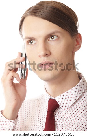 Serious businessman talking via cell phone on a white background - stock photo