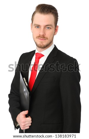 Serious businessman wearing a black suit and red tie, with a folder. White background.