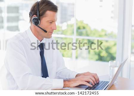 Serious businessman wearing a headset for customer service