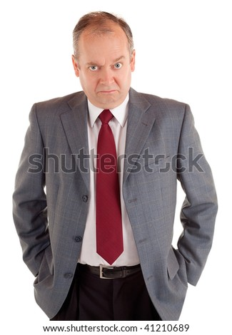 Serious Businessman with a Scowling Expression - stock photo