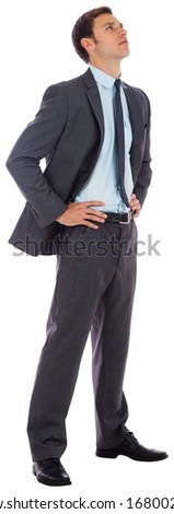 Serious businessman with hands on hips on white background