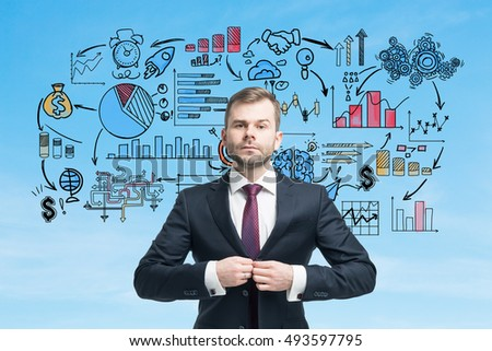 Serious businessman with red tie is buttoning his vest against blue wall with startup sketch on it. Concept of small business founder