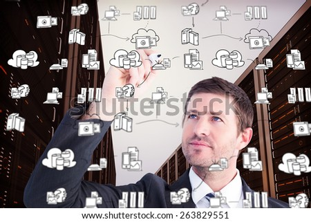 Serious businessman writing with marker against cloud computing doodle - stock photo