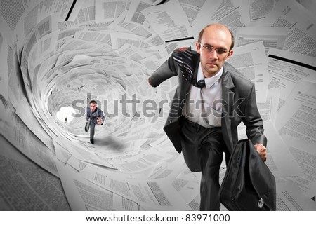 Serious businessmen running inside big documents tunnel - stock photo
