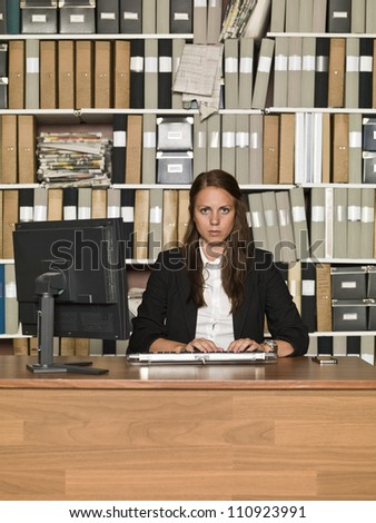 Serious Businesswoman at the office - stock photo