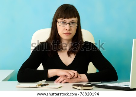 Serious businesswoman in office - stock photo
