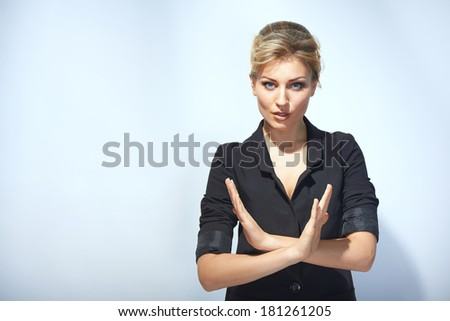 Serious businesswoman making stop sign - stock photo