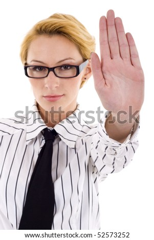 Serious businesswoman making stop sign over white, focus on hand - stock photo