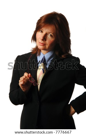 Serious businesswoman or lawyer holding glasses, making a point - stock photo