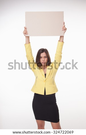 serious businesswoman showing board or banner with copy space on white background  - stock photo