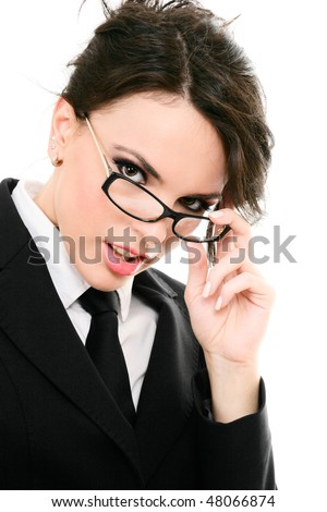 Serious businesswoman touching glasses isolated on white background - stock photo