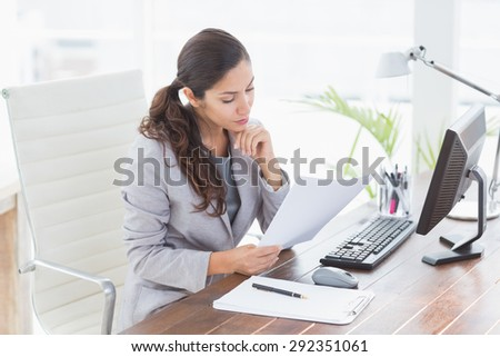 Serious businesswoman working in her office