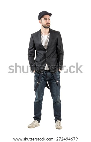 Serious calm handsome model with baseball cap looking away. Full body length portrait isolated over white background.  - stock photo