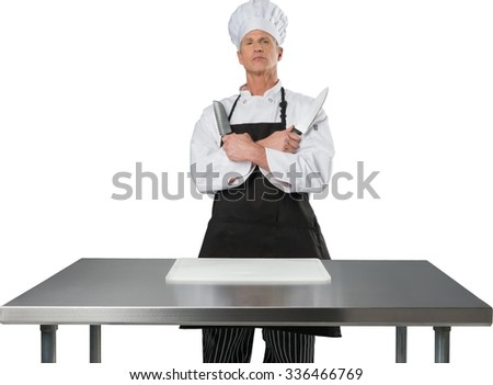 Serious Caucasian Chef  in uniform holding two knives - Isolated - stock photo