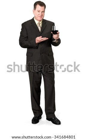 Serious Caucasian elderly man with short medium brown hair in business formal outfit holding wine glass - Isolated - stock photo