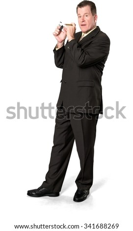 Serious Caucasian elderly man with short medium brown hair in business formal outfit using cigar - Isolated