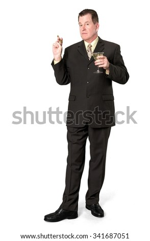 Serious Caucasian elderly man with short medium brown hair in business formal outfit using martini glass - Isolated