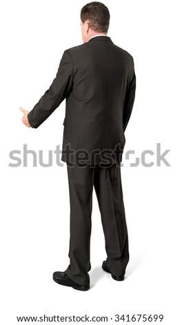 Serious Caucasian elderly man with short medium brown hair in business formal outfit with hands in pockets - Isolated