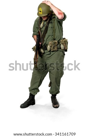 Serious Caucasian man in uniform holding machine gun - Isolated