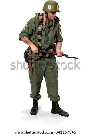 Serious Caucasian man in uniform holding shovel - Isolated