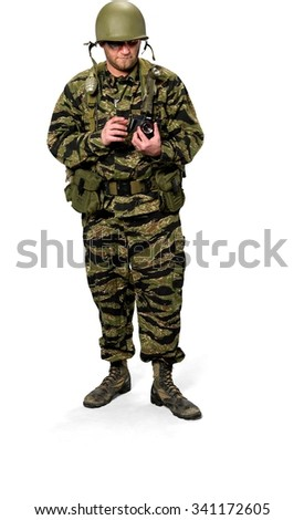 Serious Caucasian man in uniform using camera - Isolated - stock photo