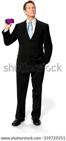 Serious Caucasian man with short black hair in business formal outfit holding screen surface - Isolated - stock photo