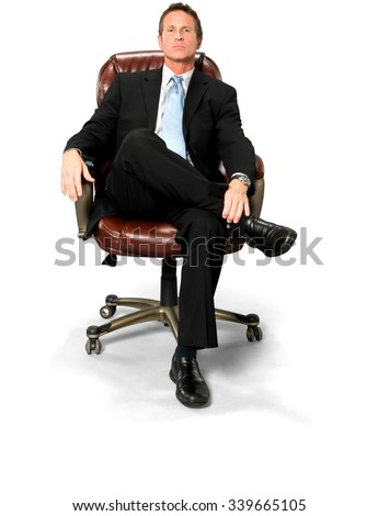serious caucasian man with short black hair in business formal outfit with hands holding leg - Office Chair For Short Person