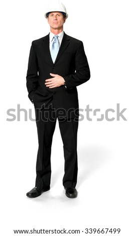 Serious Caucasian man with short black hair in business formal outfit with hands on stomach - Isolated