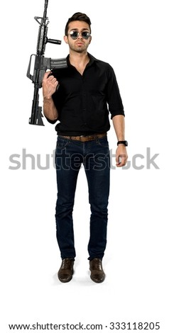 Serious Caucasian man with short black hair in casual outfit holding rifle - Isolated