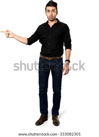 Serious Caucasian man with short black hair in casual outfit pointing using finger - Isolated