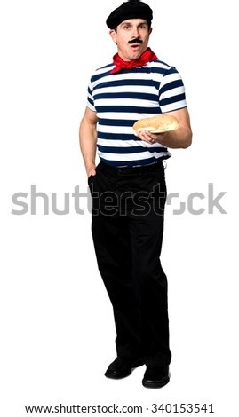 Serious Caucasian man with short black hair in costume holding food - Isolated