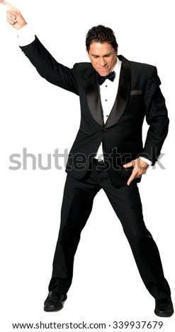 Serious Caucasian man with short black hair in evening outfit dancing - Isolated - stock photo
