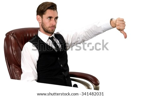 Serious Caucasian man with short dark brown hair in business formal outfit giving thumbs down - Isolated - stock photo