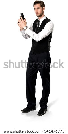 Serious Caucasian man with short dark brown hair in business formal outfit holding handgun - Isolated