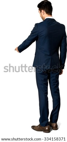 Serious Caucasian man with short dark brown hair in business formal outfit pointing using finger - Isolated - stock photo