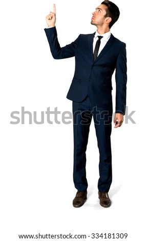 Serious Caucasian man with short dark brown hair in business formal outfit pointing using finger - Isolated
