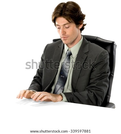 Serious Caucasian man with short dark brown hair in business formal outfit typing on imaginary prop office chair - Isolated