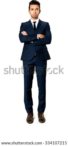 Serious Caucasian man with short dark brown hair in business formal outfit with arms folded - Isolated