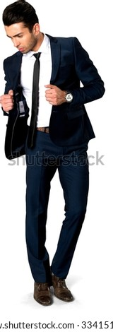 Serious Caucasian man with short dark brown hair in business formal outfit with hands holding lapels - Isolated