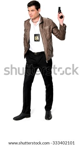 Serious Caucasian man with short dark brown hair in casual outfit holding handgun - Isolated - stock photo
