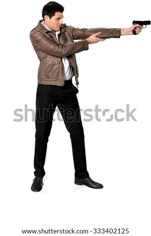 Serious Caucasian man with short dark brown hair in casual outfit using handgun - Isolated