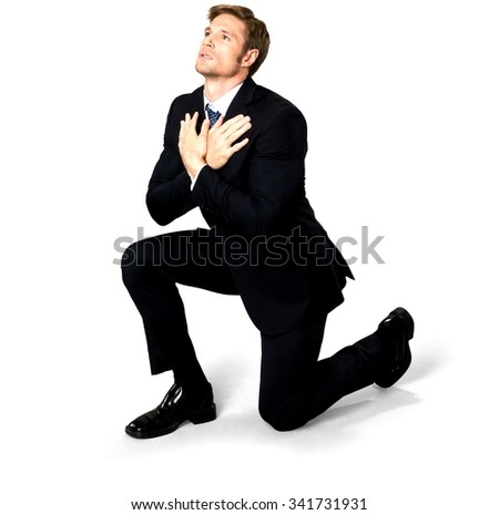 Serious Caucasian man with short medium blond hair in business formal outfit begging - Isolated - stock photo