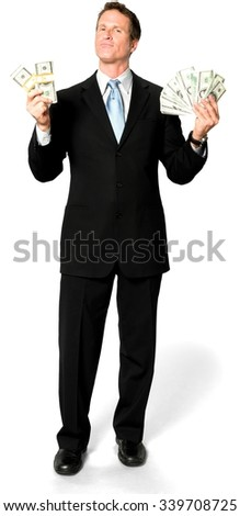 Serious Caucasian man with short medium blond hair in business formal outfit holding money - Isolated