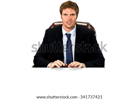 Serious Caucasian man with short medium blond hair in business formal outfit typing on imaginary prop office chair - Isolated - stock photo