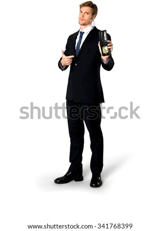 Serious Caucasian man with short medium blond hair in business formal outfit using police badge - Isolated