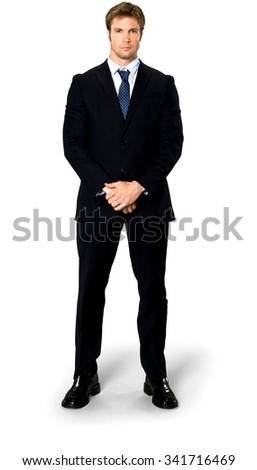 Serious Caucasian man with short medium blond hair in business formal outfit with hands covering crotch - Isolated