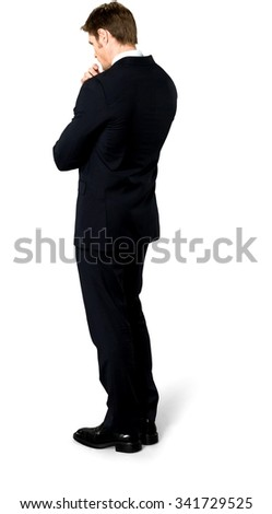 Serious Caucasian man with short medium blond hair in business formal outfit with hands holding elbow - Isolated