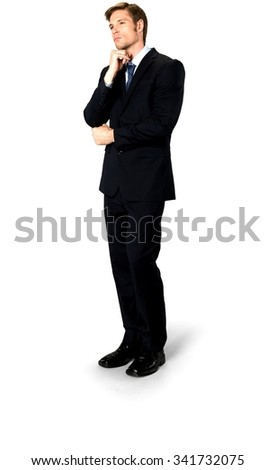 Serious Caucasian man with short medium blond hair in business formal outfit with head resting on fist - Isolated